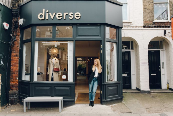 The characterful shop front at Diverse with the owner stood in the doorway