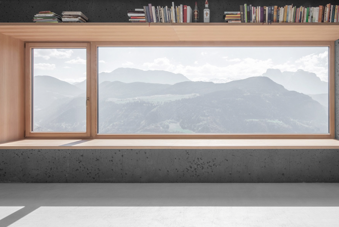 A view of a mountain through a minimal window design