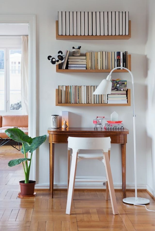An image of shelving above a desk space to represent a tidy space for higher productivity