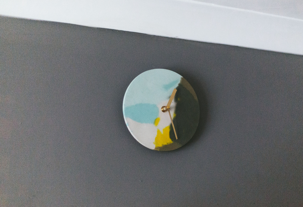 Coloured concrete clock on a wall