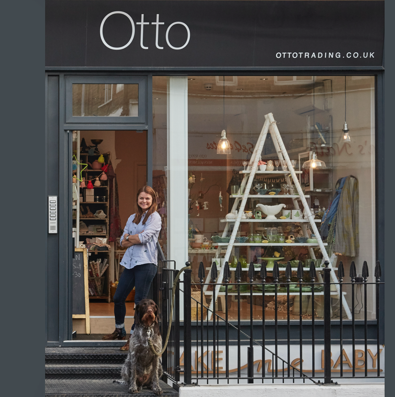 Otto the dog outside his shop front