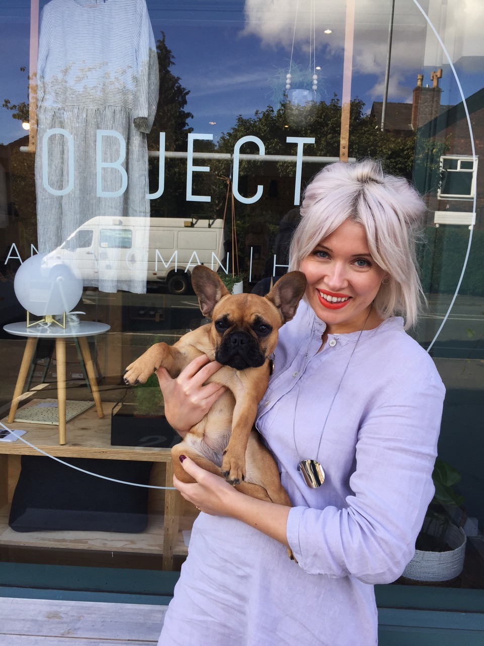 Polly outside her independent shop with her dog