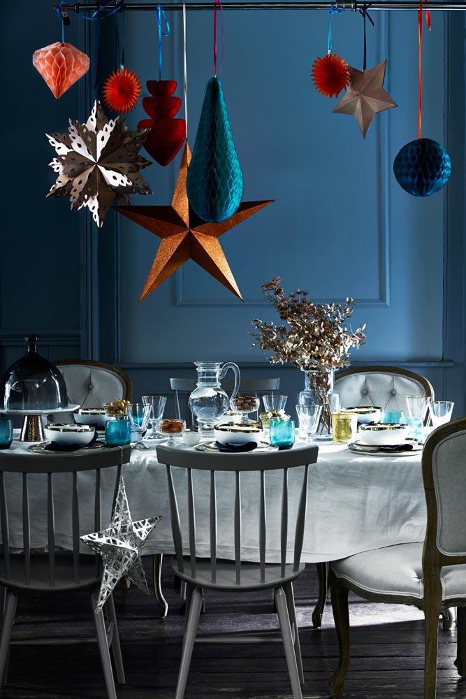 A brightly coloured Christmas table in shades of blue, green, and orange