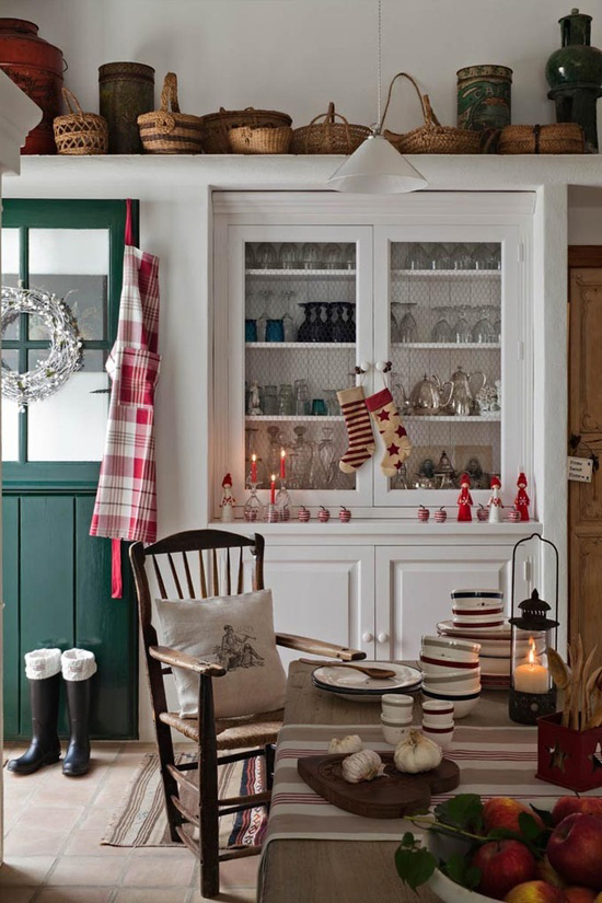 A warm, cosy Christmas kitchen decorated with rustic soft furnishings and decorations