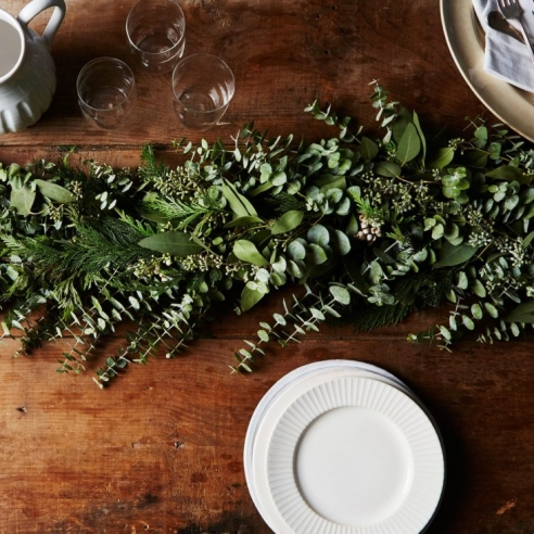 A table garland of eucalyptus, pine and tallow berries