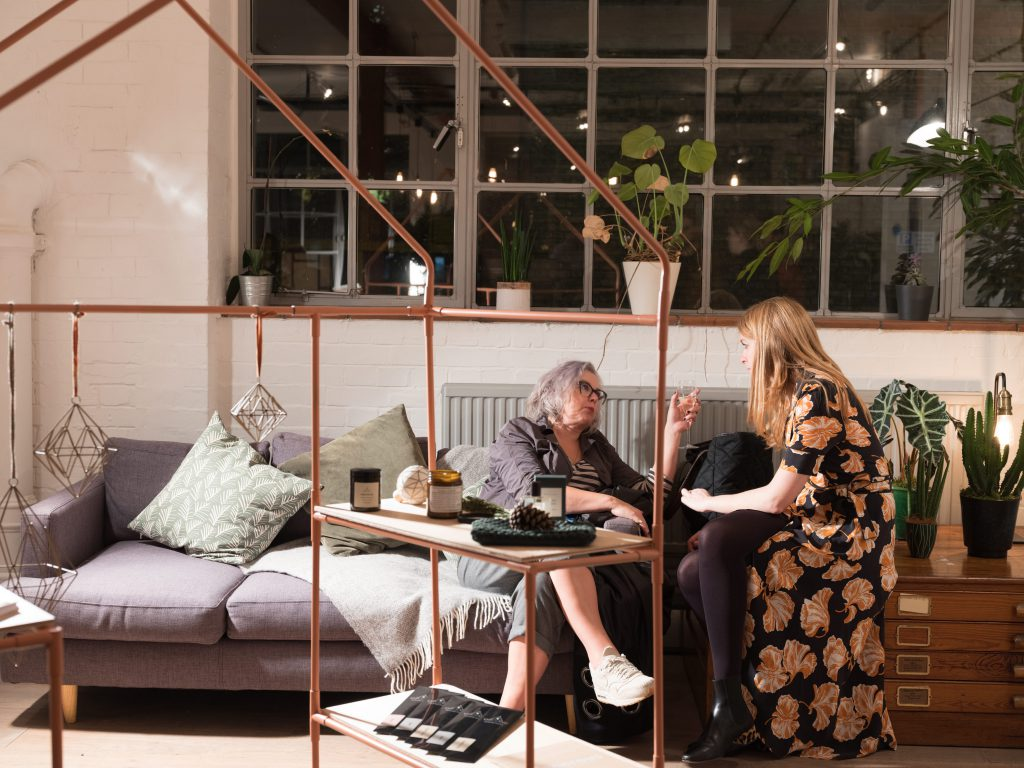 Creative Director Lucy Ward sitting on a sofa, speaking to Kate from Mad About the House