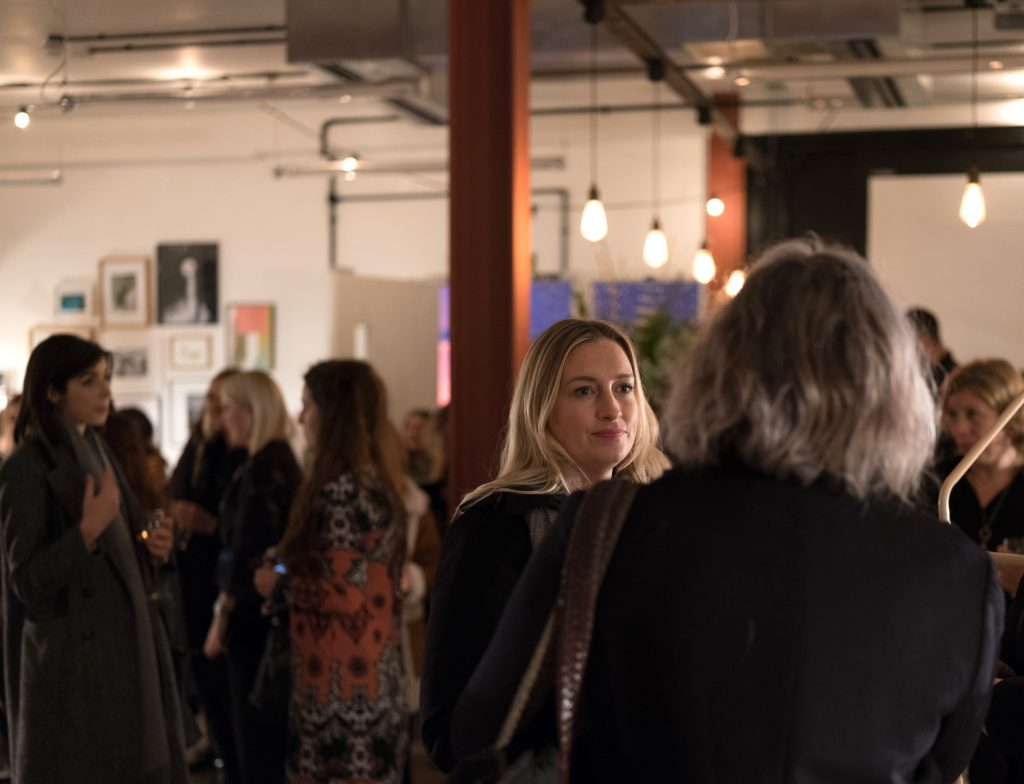 Guests mingling at the Christmas event