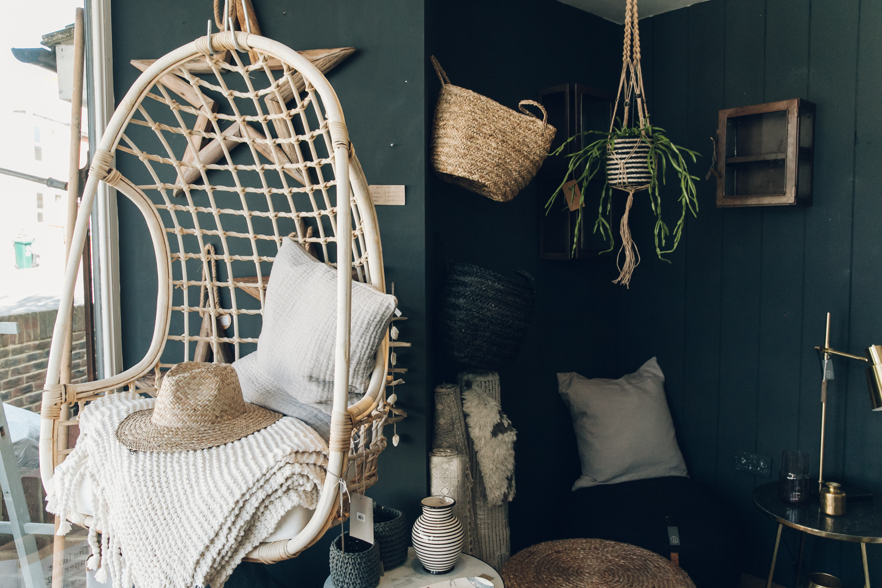 Hanging wicker chair suspended in an independent shop