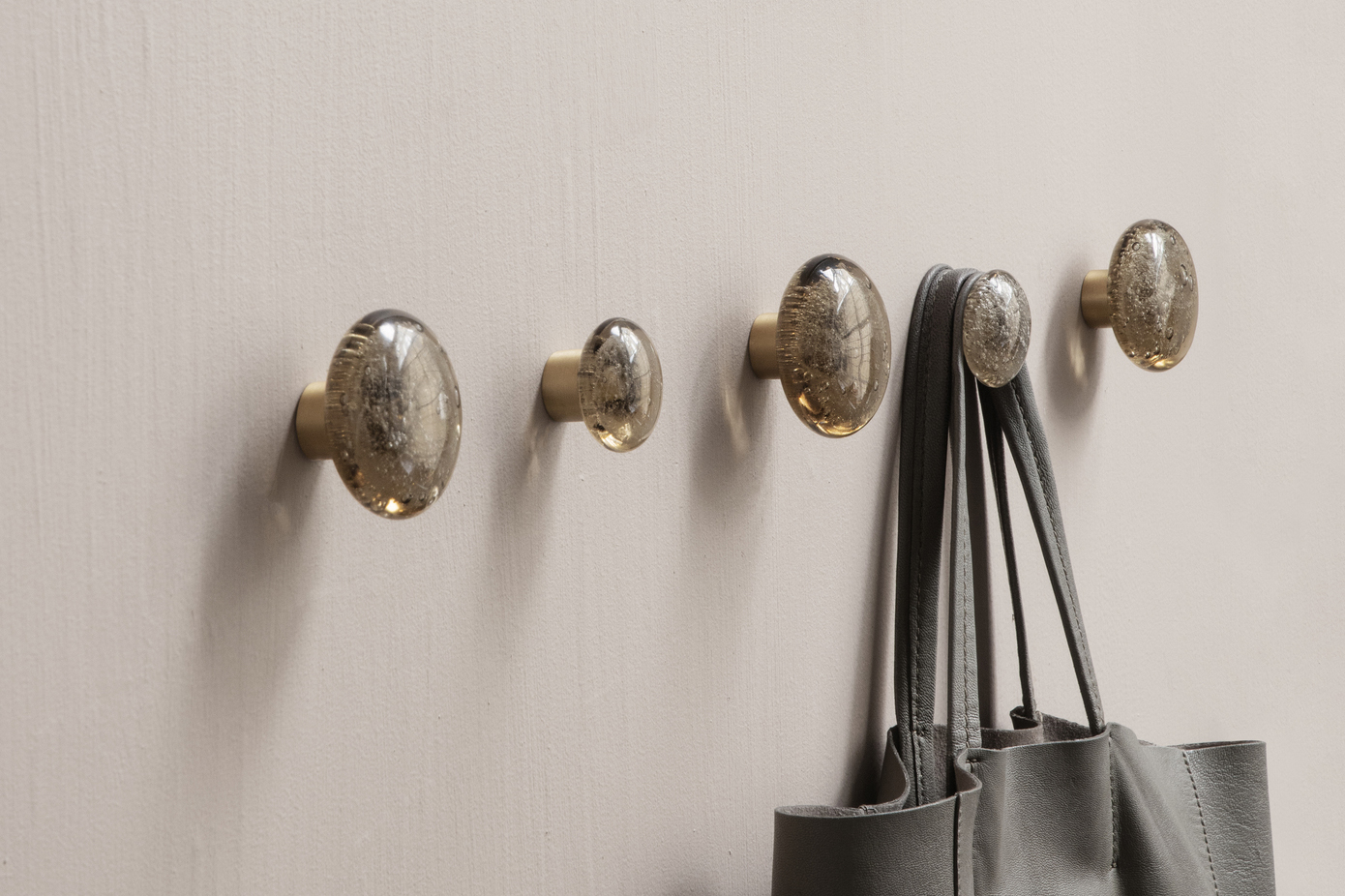 Trouva invest in wall hooks as storage for small homes